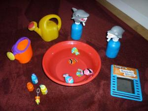 Swim Toys: Watering can, squirt bottles, bubbles, plastic bowl, fish puppets and mirror.